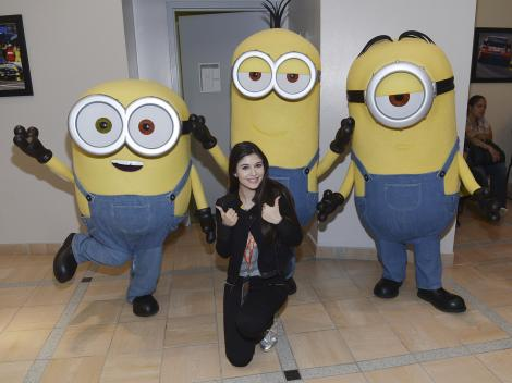 HOMESTEAD, FL - NOVEMBER 22: Elizabeth Elias with the Minions at NASCAR Ford Championship Weekend in celebration of the Minions on digital HD on November 24 and Blu-ray & DVD on December 8, on November 22, 2015 in Homestead, United States. (Photo by Gustavo Caballero/Getty Images For Universal Pictures Home Entertainment)