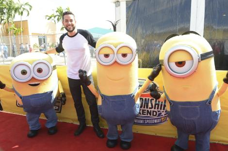 HOMESTEAD, FL - NOVEMBER 22: Zachary Levi with the Minions at NASCAR Ford Championship Weekend in celebration of the Minions on digital HD on November 24 and Blu-ray & DVD on December 8, on November 22, 2015 in Homestead, United States. (Photo by Gustavo Caballero/Getty Images For Universal Pictures Home Entertainment)