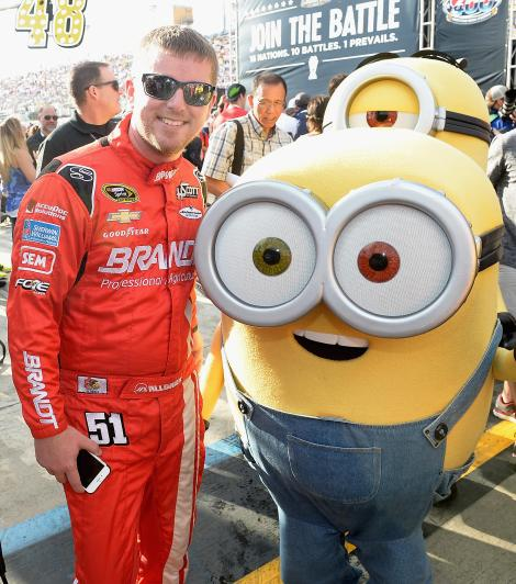 HOMESTEAD, FL - NOVEMBER 22: Justin Allgaier and the Minion Bob at NASCAR Ford Championship Weekend in celebration of Minions on digital HD on November 24 and Blu-ray & DVD on December 8. (Photo by Gustavo Caballero/Getty Images For Universal Pictures Home Entertainment)