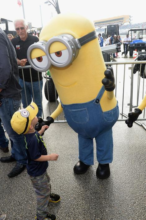 HOMESTEAD, FL - NOVEMBER 22: The Minion Kevin meets a young fan at NASCAR Ford Championship Weekend in celebration of Minions on digital HD on November 24 and Blu-ray & DVD on December 8. (Photo by Gustavo Caballero/Getty Images For Universal Pictures Home Entertainment)